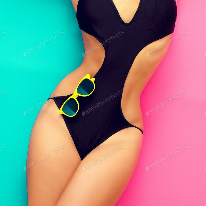 fashion girl in a bathing suit on a bright background