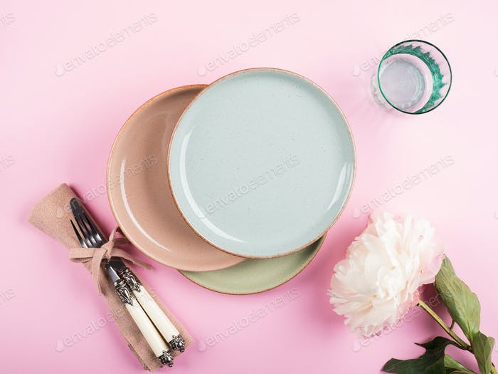 Pastel color dishes on pink