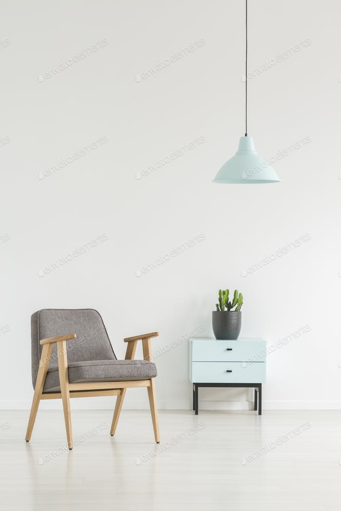 Minimal room interior with a retro armchair, small cabinet with Foto von  bialasiewicz auf Envato Elements