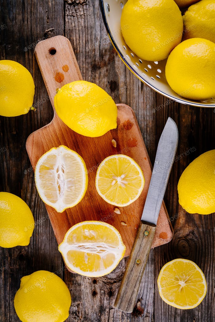 fresh organic cut lemons on a wooden background. Top view