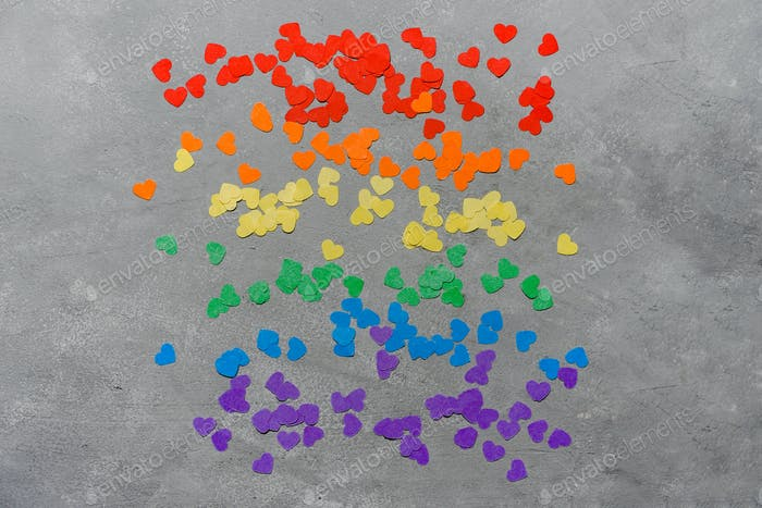 Rainbow colored hearts on gray