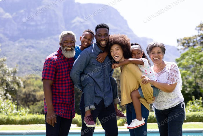 Multi-generation mixed race family enjoying their time at a garden