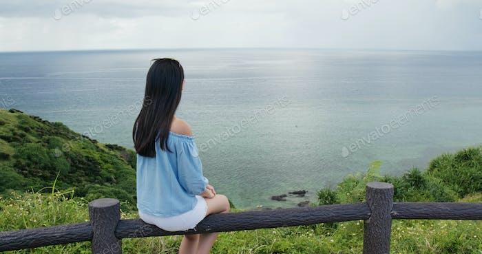 Woman enjoy the sea view at ishigaki island