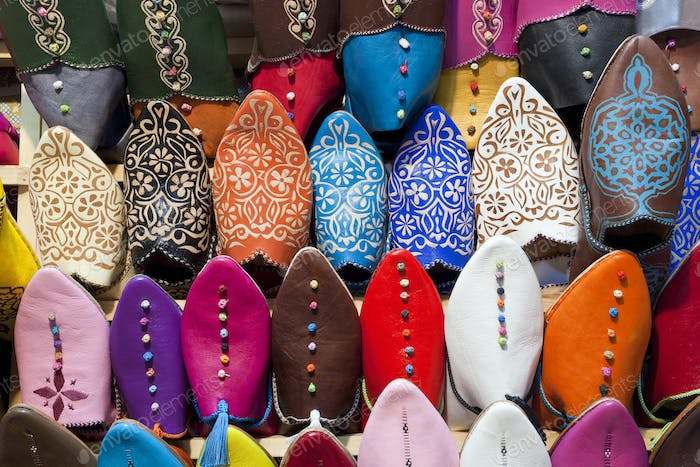 High angle close up of colourful leather slippers at a traditional North African market.