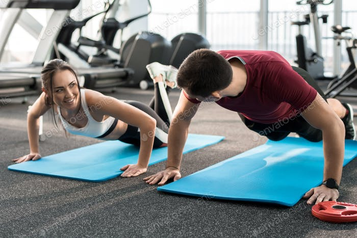 Fitness Couple Exercising in Gym
