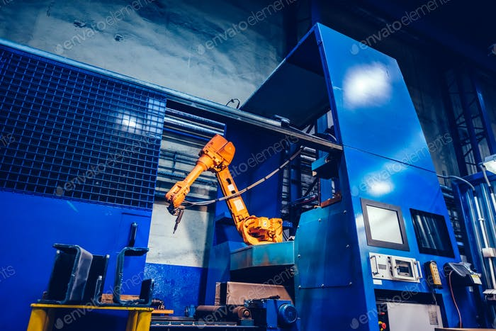 Robotic arm in a factory. Modern heavy industry, machine learning