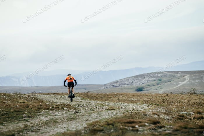 Mountainbiker on Cycle Rides on Mountain Trail