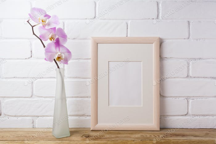 Wooden frame mockup with tender pink orchid