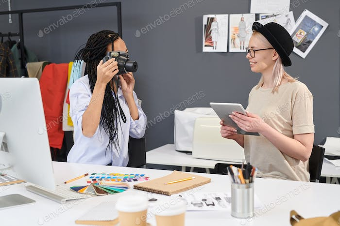 Designers photographing themselves in studio