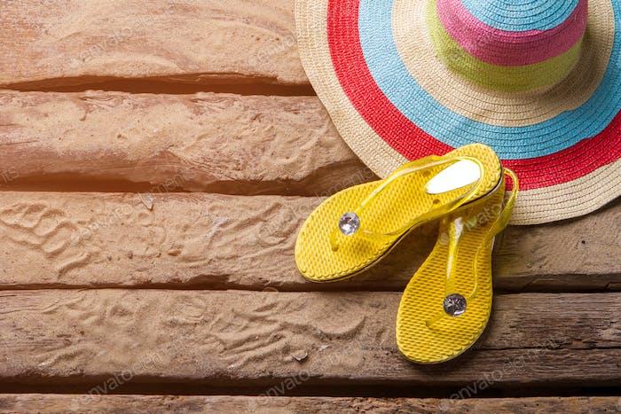 Flip flops near a hat