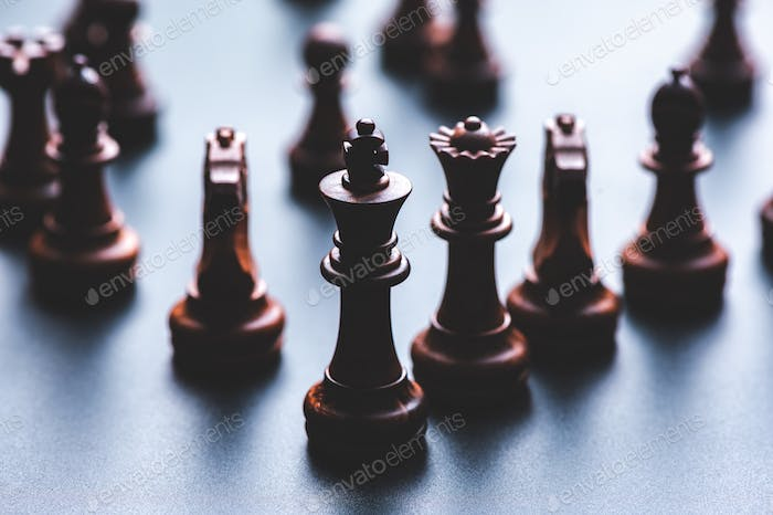 Chess pieces board game in business success leadership concept
