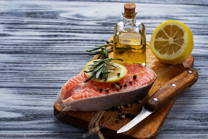 Raw salmon with lemon and rosemary