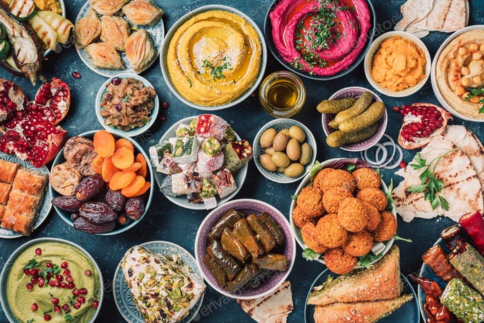 Arabic traditional cuisine. Middle Eastern colorful hummus, pita, falafel, dolma, baklava, halva
