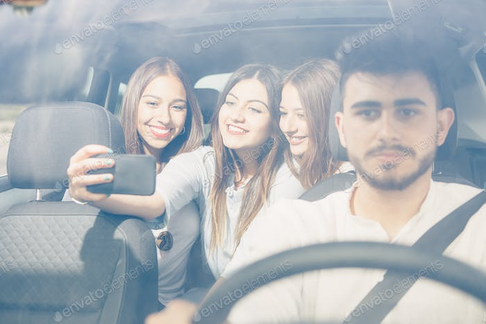 Selfie with a smartphone in the car