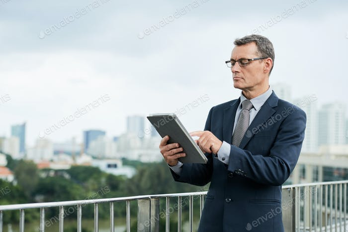Entrepreneur with digital tablet
