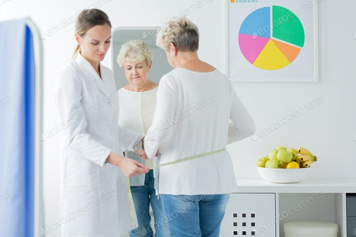 Dietician measuring a woman