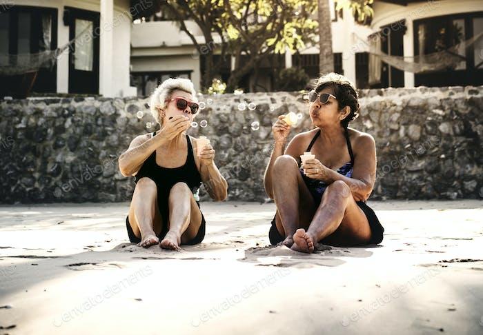 Mature women tanning on the beach