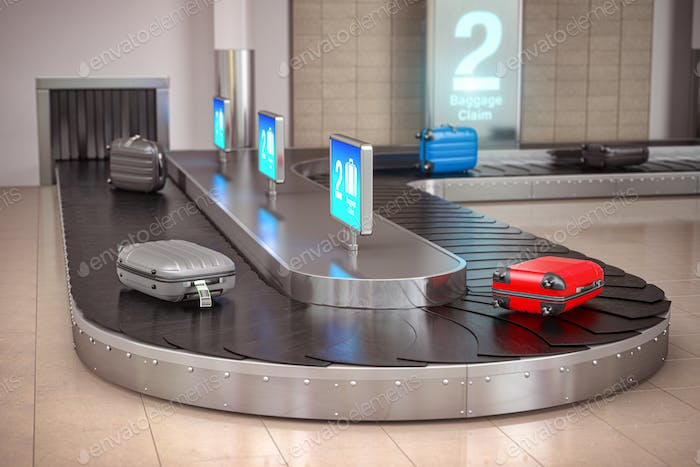 Suitcases on the airport luggage conveyor belt. Baggage claim. A
