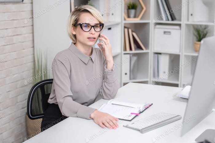 Female Manager Talking to Client by Phone