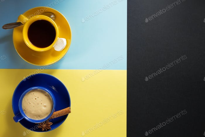cup of coffee  and cacao at colorful background