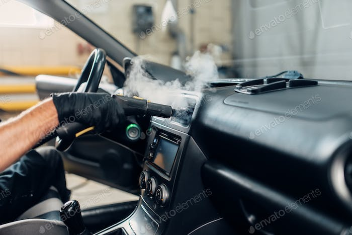 Carwash, removing dust and dirt with steam cleaner
