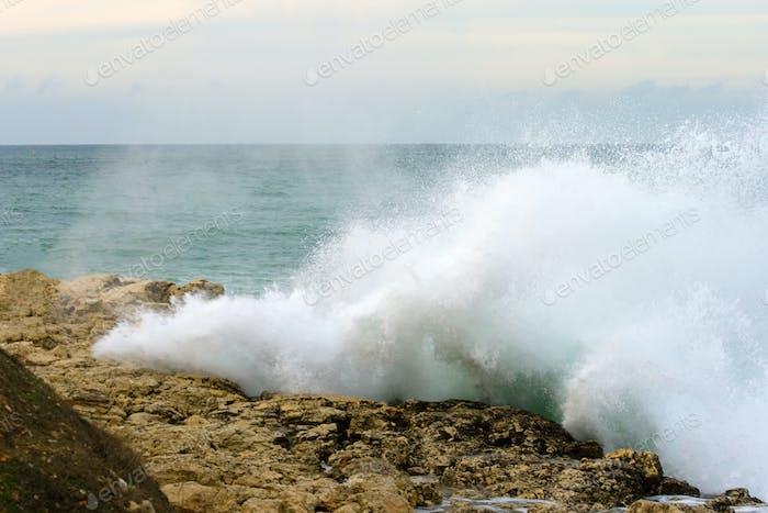 Big wave shattered on the rocks