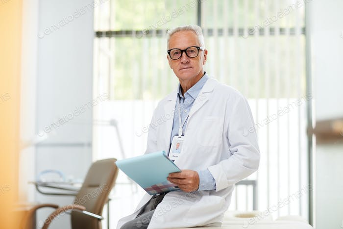 Mature Doctor Looking at Camera