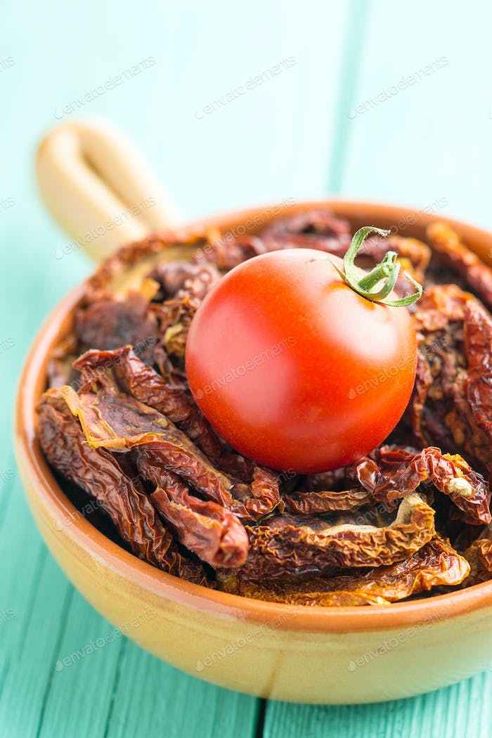 Dried sliced tomatoes and fresh tomatoes.
