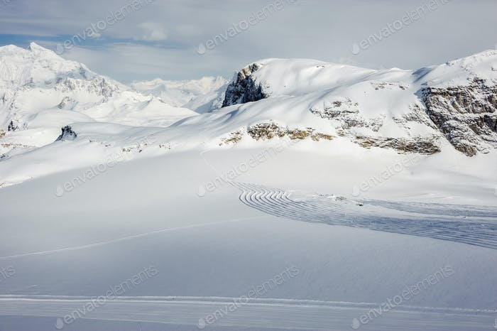 Alpine winter mountain landscape. French Alps with snow.