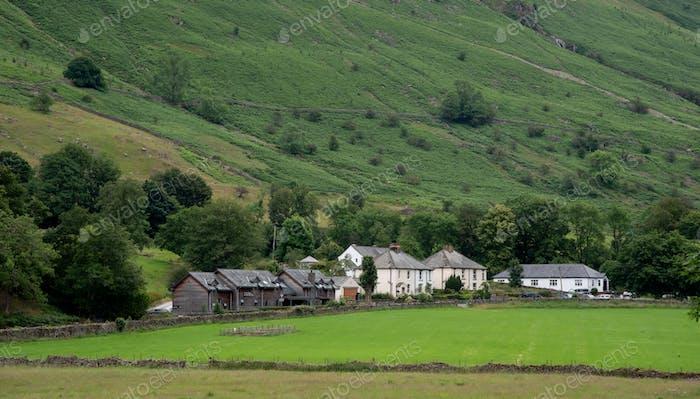 Cottage houses at the edge of the cliff e farmland Lake District United Kingdom