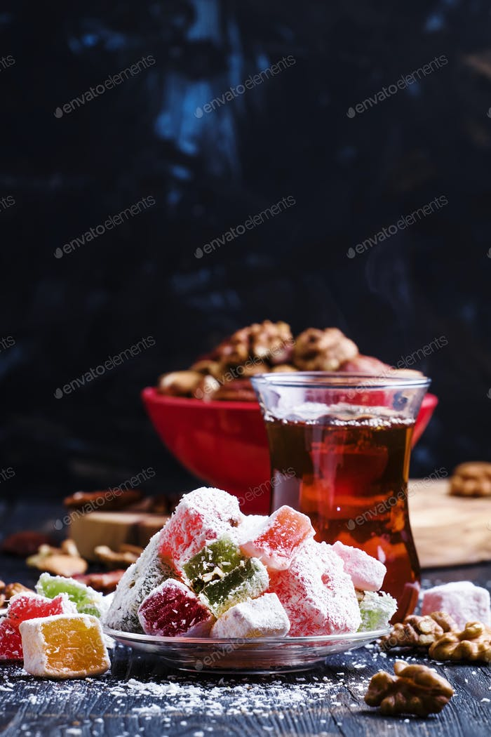 Black tea and candy with nuts