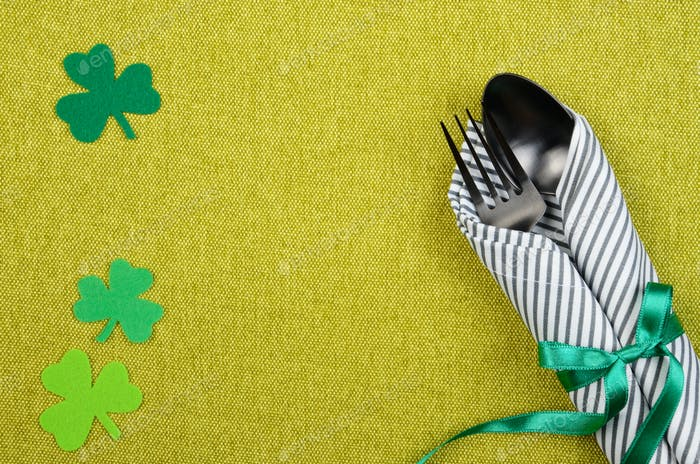 St. Patricks day flat lay set with silverware fork, spoon and napkin