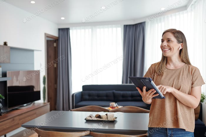 Woman controlling smart home system