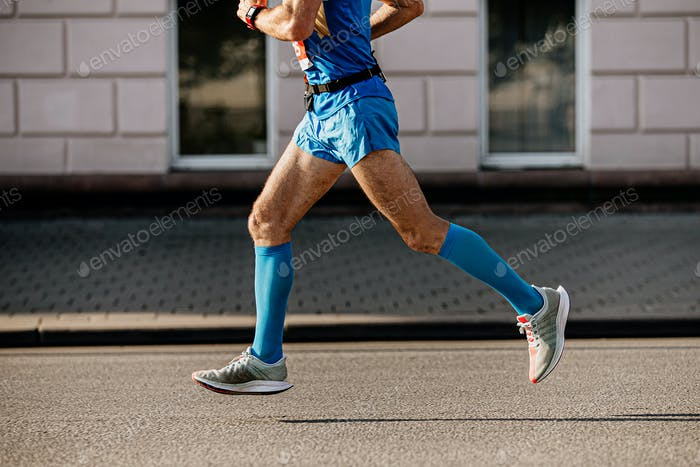 athlete runner in blue compression socks