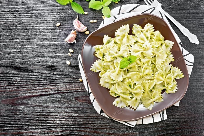 Farfalle with pesto in plate on board top