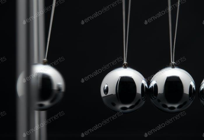 Closeup Of Newton Balls With Swinging Metal Spheres