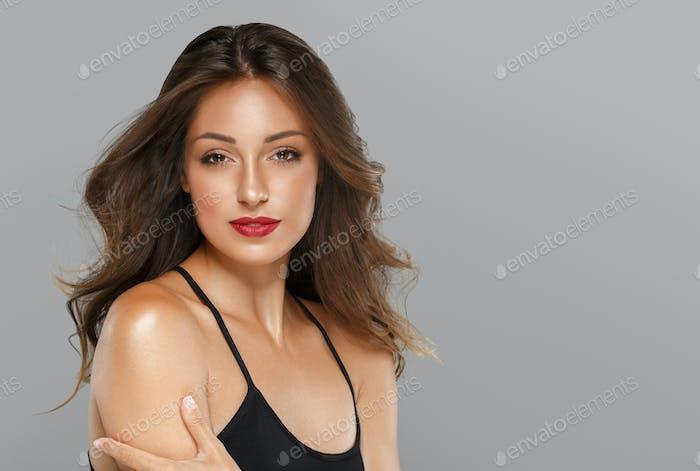 Beauty woman long hair red lips clean healthy skin