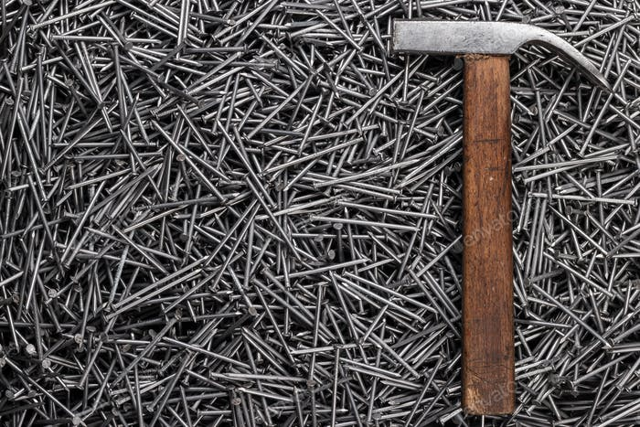 Old Hammer And Nails On Table