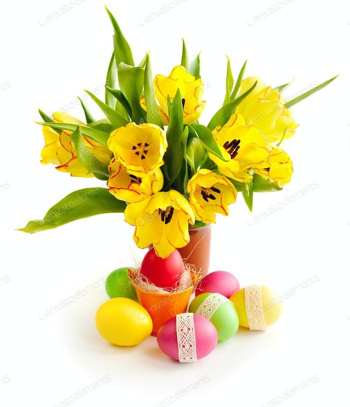 Easter eggs with bouquet tulips on white background