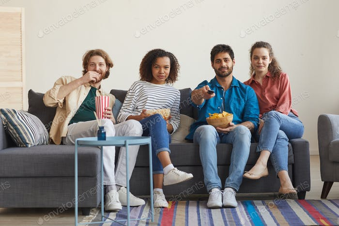 Multi Ethnic Group of Friends Watching TV