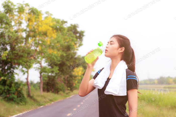 Girl are drinking water in park