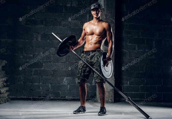 Man is changing weight for barbell