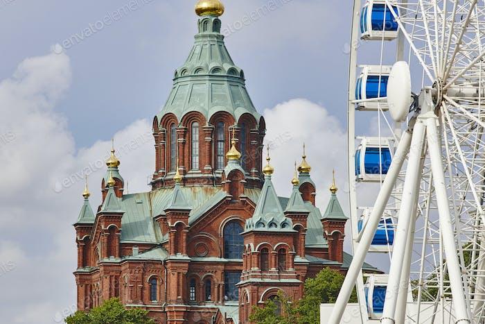 Helsinki skyline city center. Big wheel and Uspenki cathedral. Finland