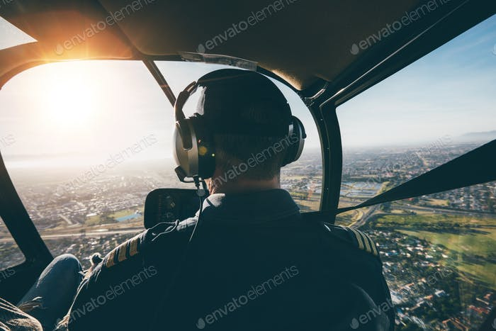 Male pilot flying a helicopter