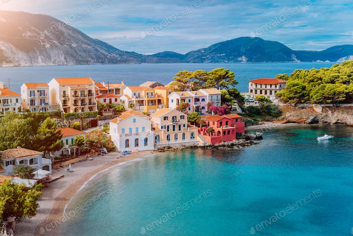 Cozy colorful town Assos with red roofs at the lush green Mediterranean place of Kefalonia Island