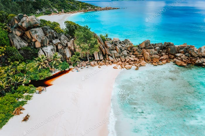 Aerial top view of Seychelles tropical paradise beach with crystal clear turquoise water and bizarre