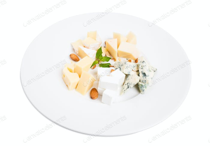 Assorted cheese platter with almonds and mint.