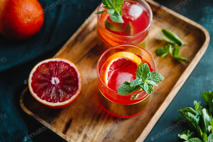 Summer cocktail with blood orange and mint.