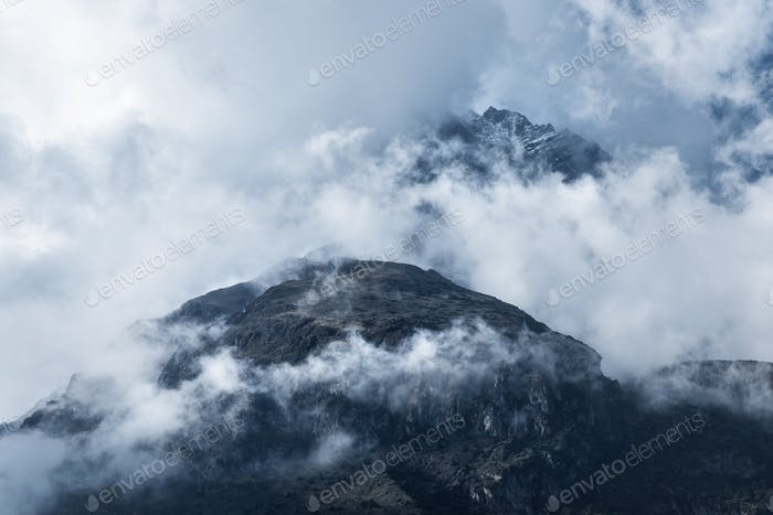 Majestical mountains in clouds in overcast evening in Nepal