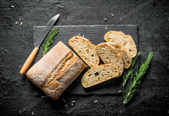 Pieces of bread ciabatta with rosemary.
